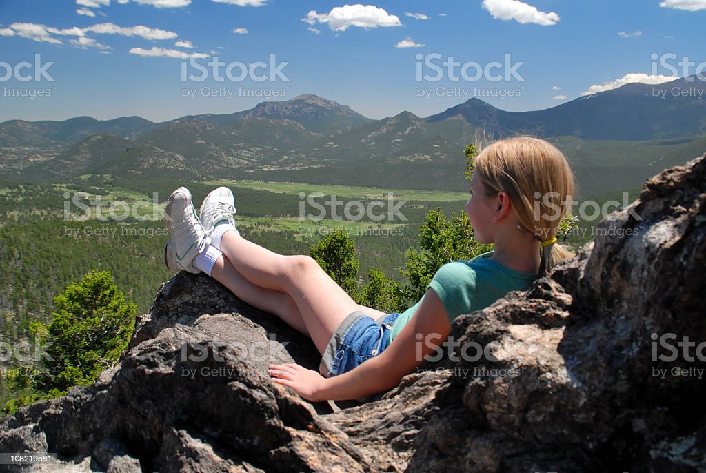 Little Girl Sitting on Mountain Top royalty-free stock photo
