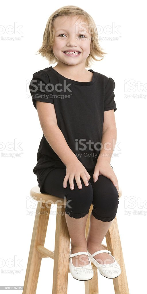 Little Girl Sitting On Stool royalty-free stock photo