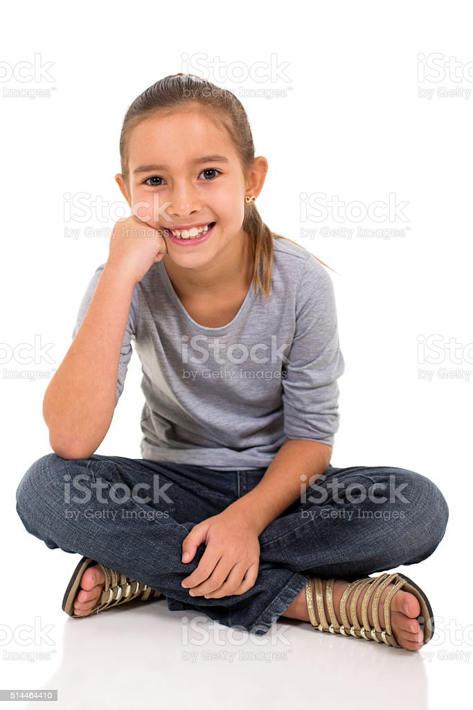 little girl sitting on white background stock photo
