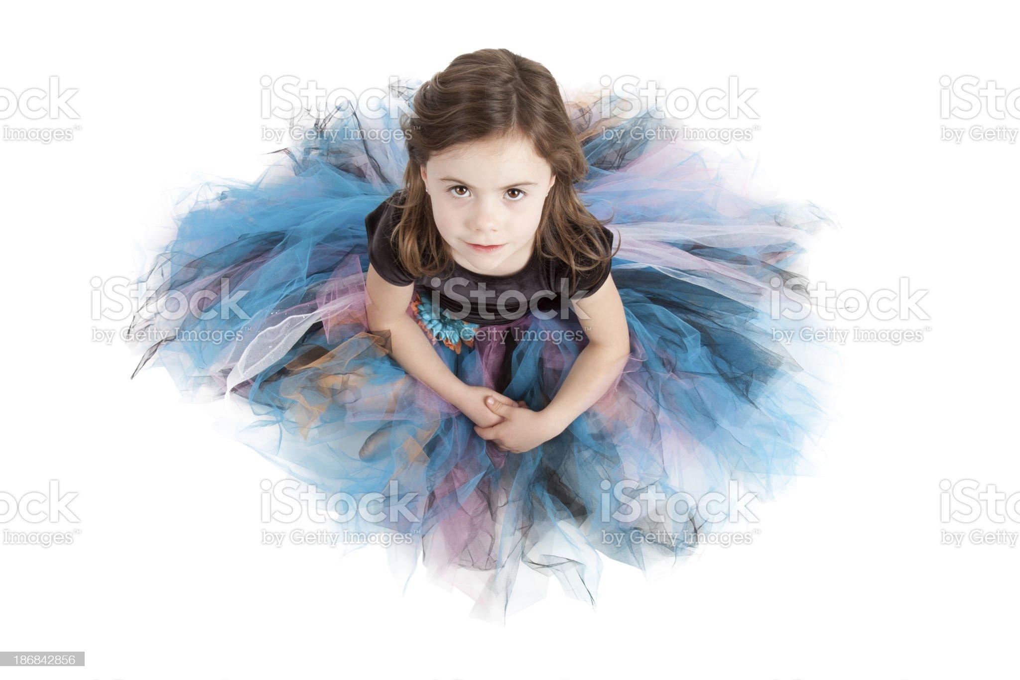 Little Girl Sitting on White Background Wearing Tutu Looking Up royalty-free stock photo