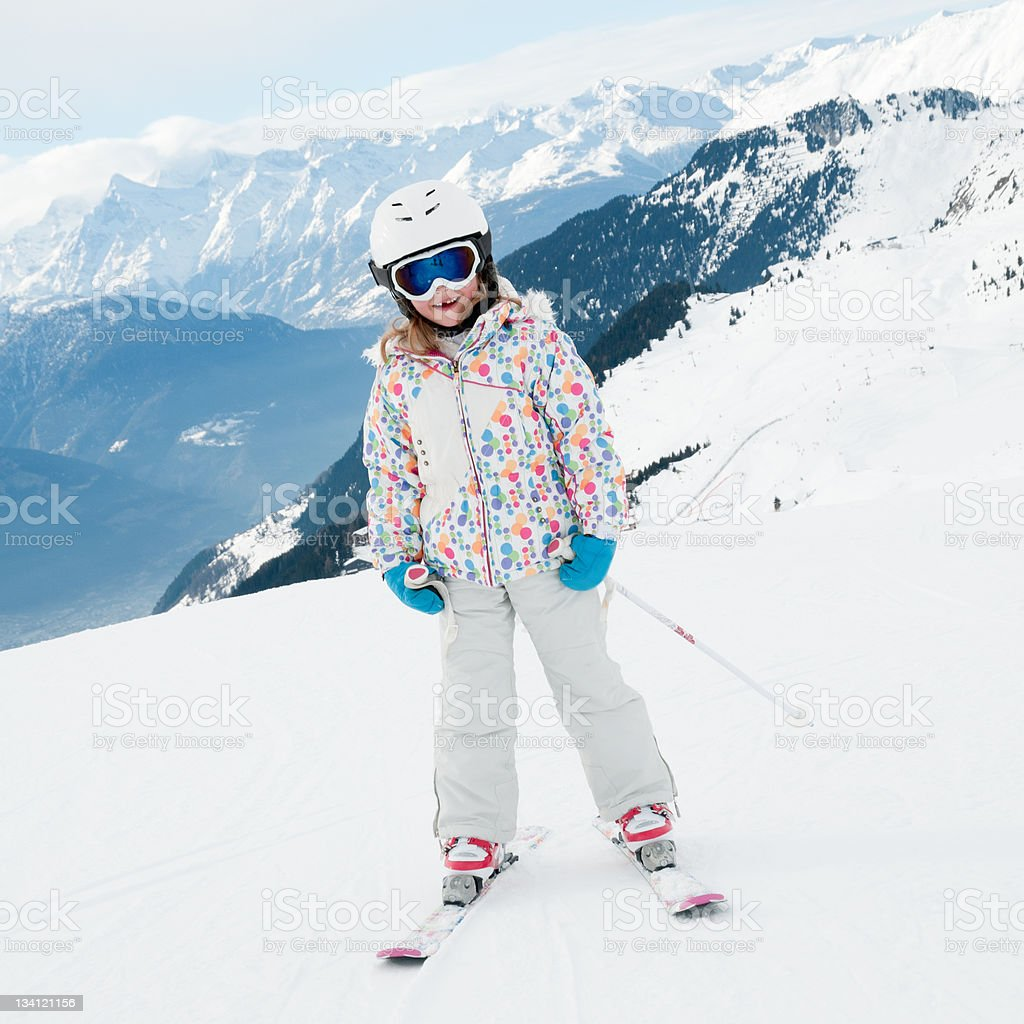 Little girl skiing in Swiss Alps royalty-free stock photo