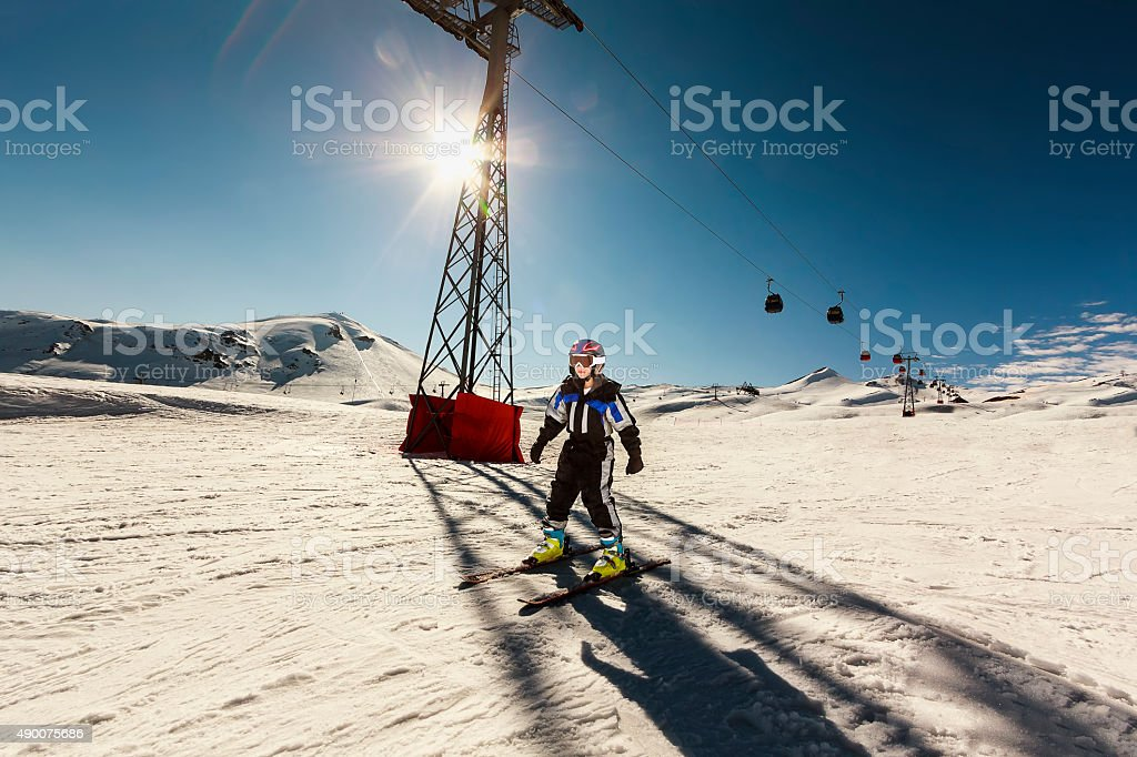 Little Girl Skiing on a Bright Sunshine Day stock photo