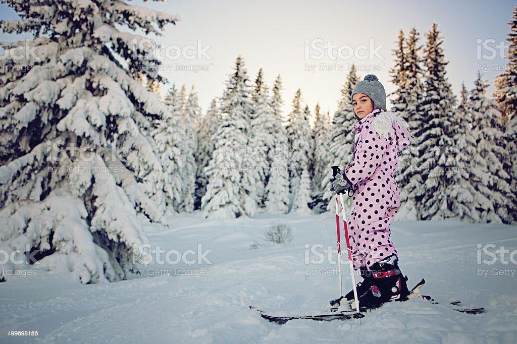 Little girl skiing stock photo