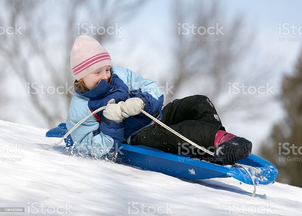 Little Girl Sledding in Winter Down Snow Covered Hill royalty-free stock photo