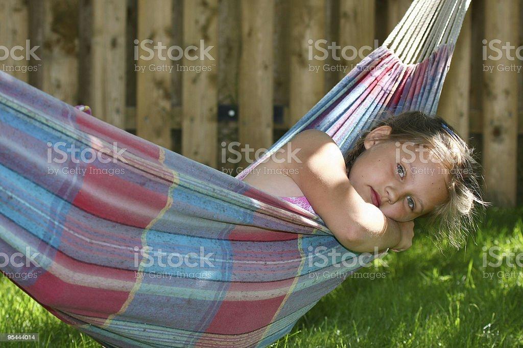 Little girl sleeping in hammock royalty-free stock photo