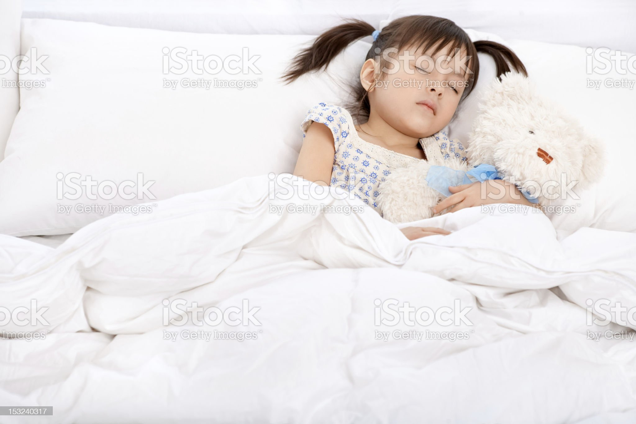 Little girl sleeping with teddy bear royalty-free stock photo