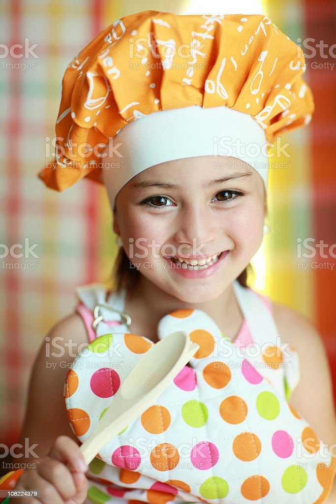Little Girl Smiling and Cooking royalty-free stock photo