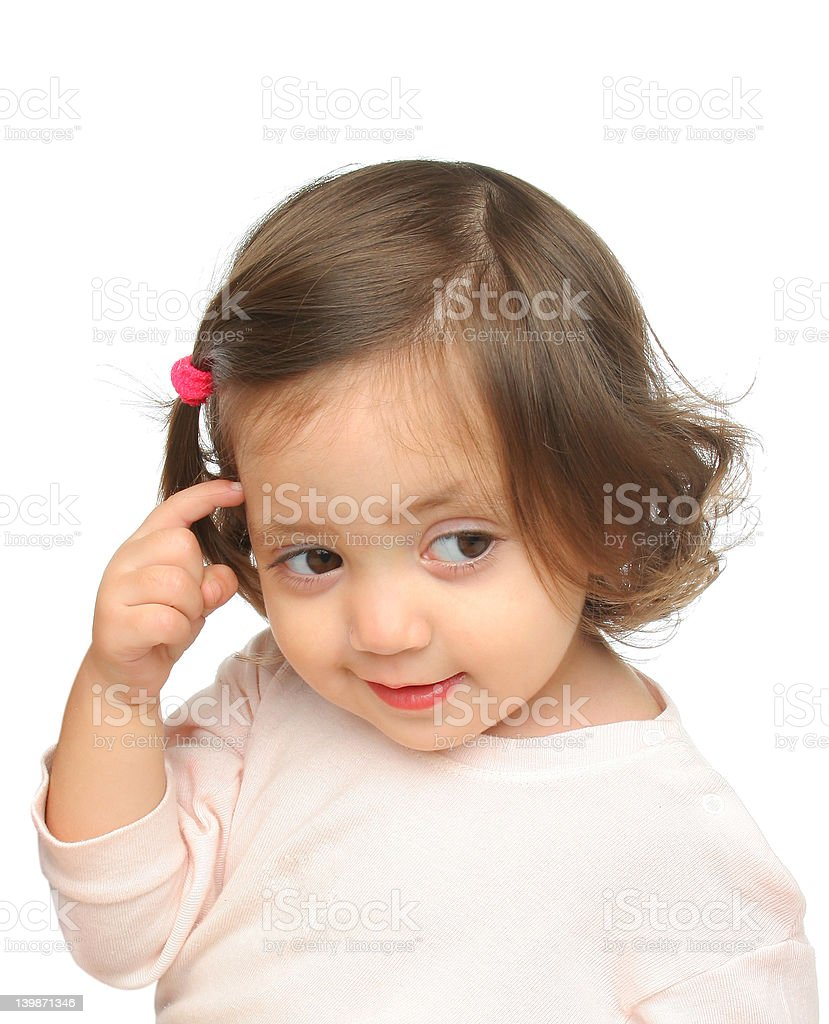 Little girl smiling and thinking royalty-free stock photo
