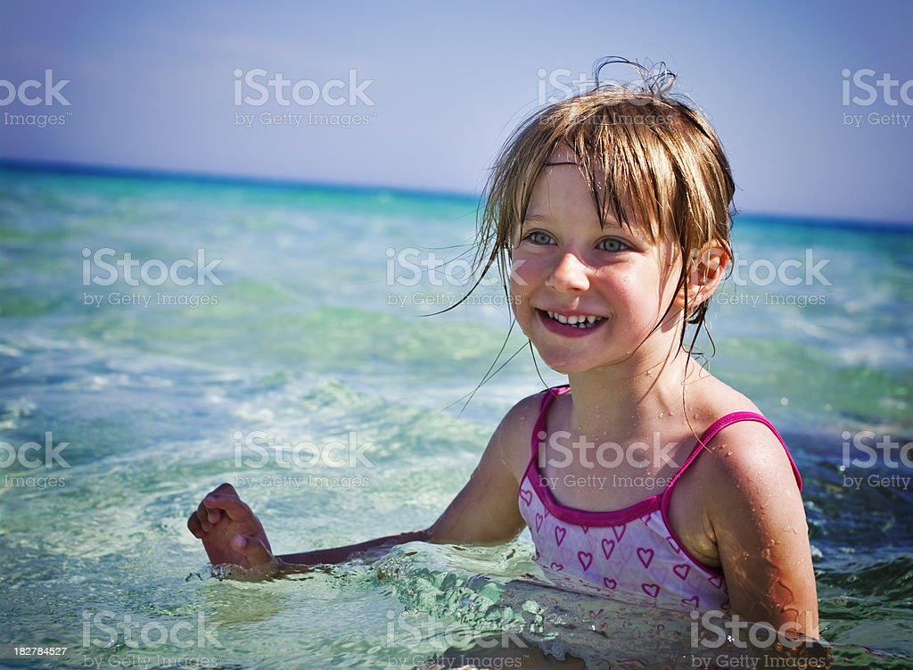 Little girl smiling in sea royalty-free stock photo