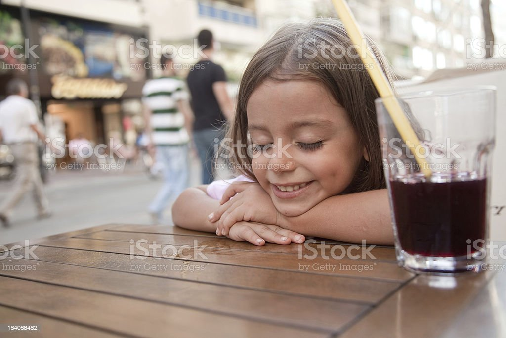 little girl smiling on the table stock photo