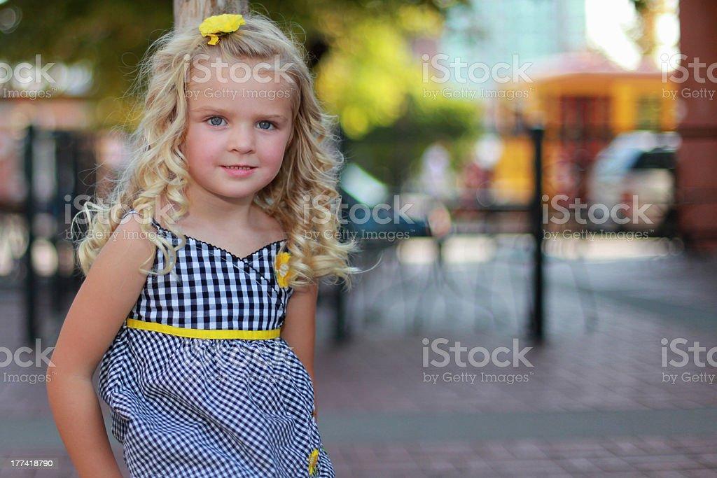 Little girl smiling outdoor stock photo