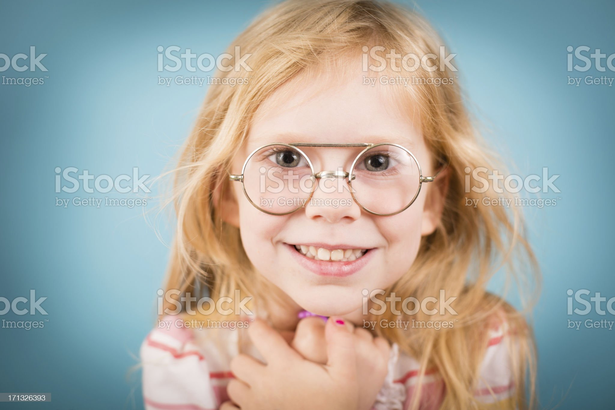 Little Girl Smiling While Wearing Vintage Nerdy Glasses royalty-free stock photo