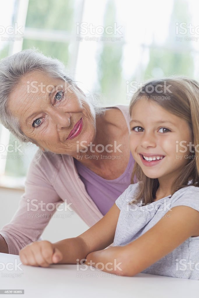 Little girl smiling with granny royalty-free stock photo