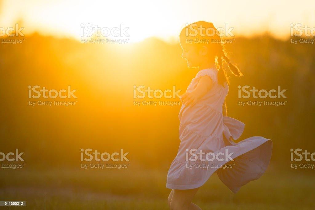Little Girl Spinning in Her Sundress stock photo