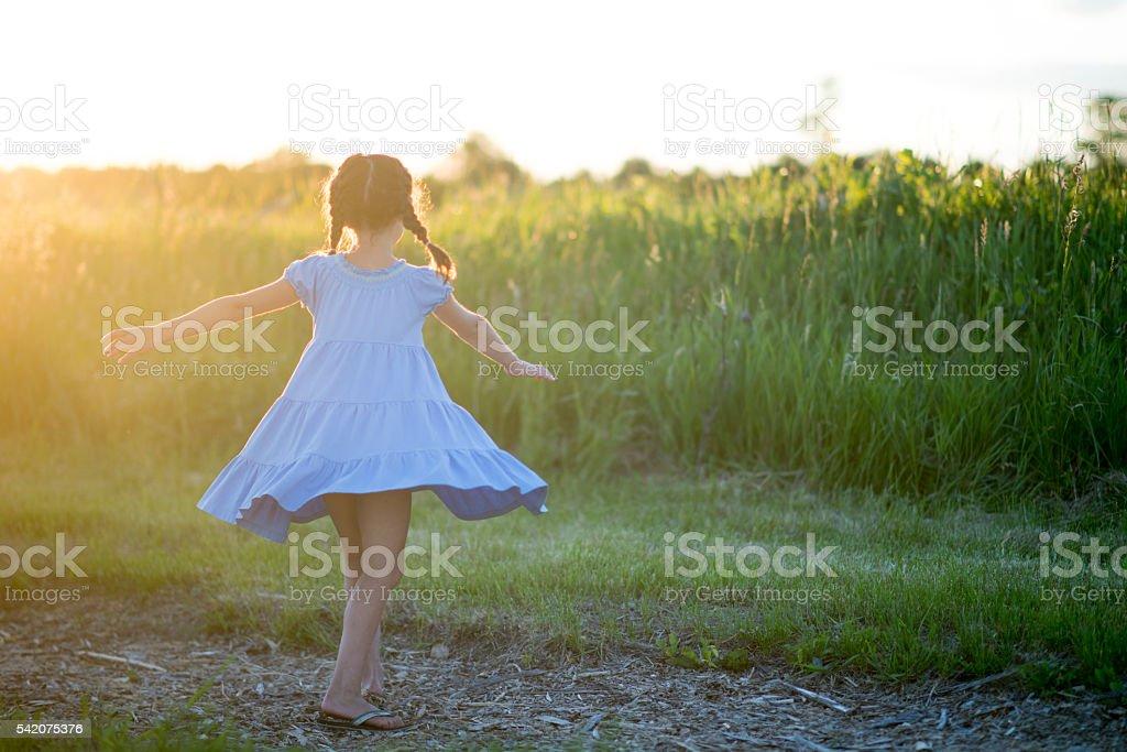 Little Girl Spinning stock photo