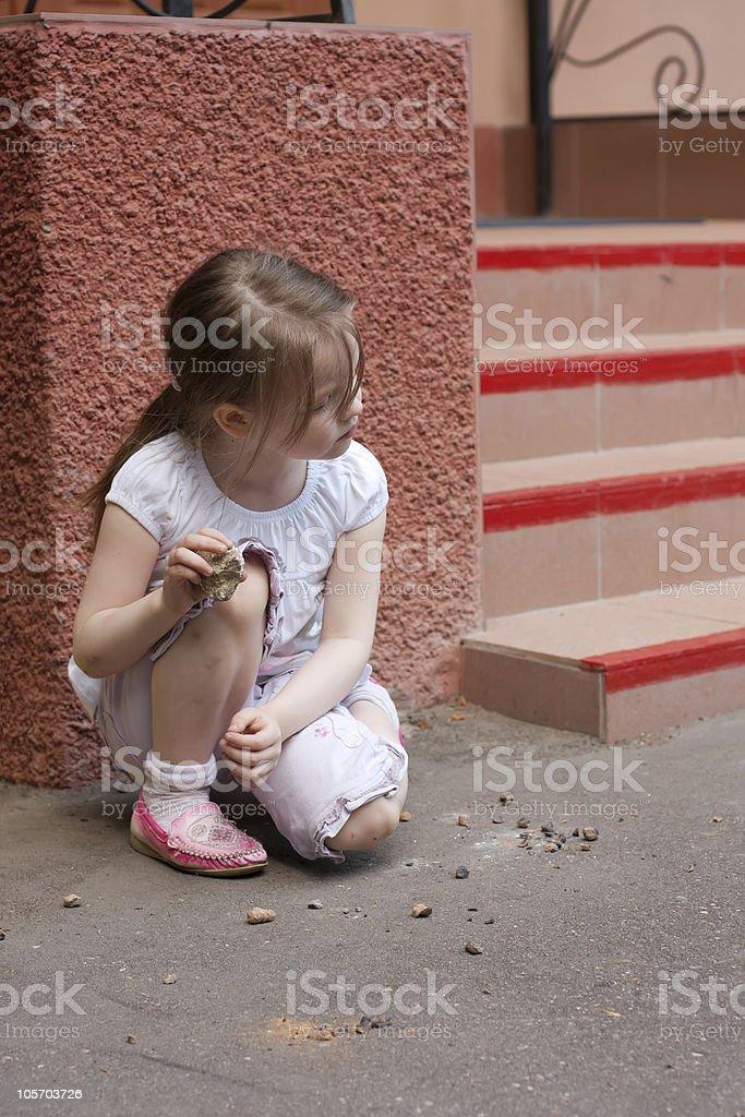 Little girl squatting royalty-free stock photo