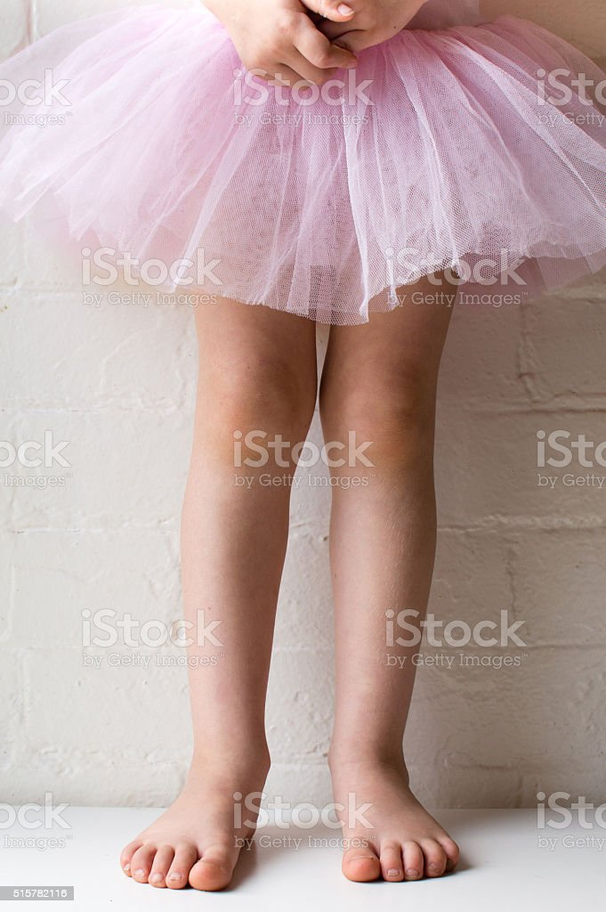 Little girl standing in pink tutu stock photo