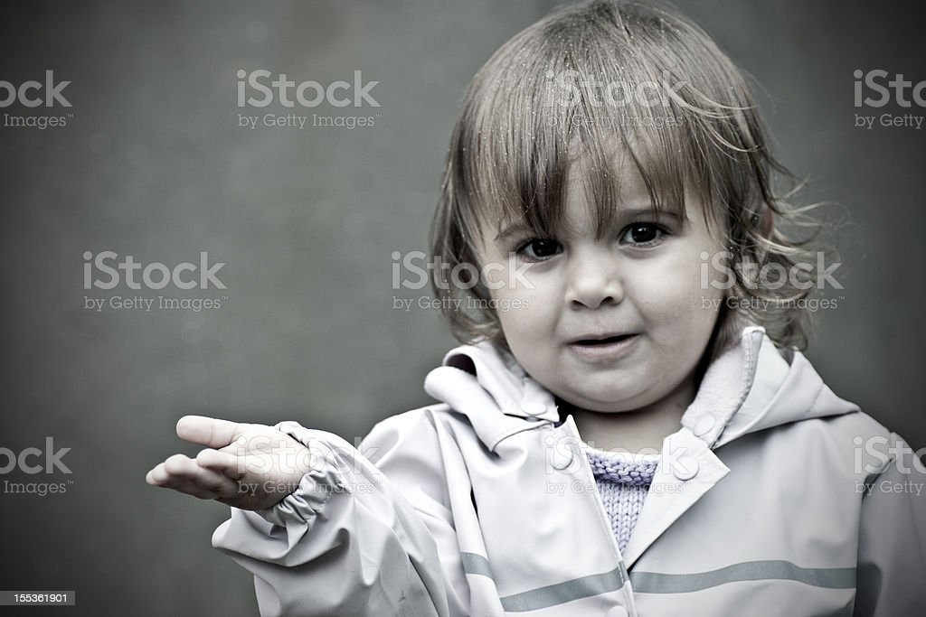 Little girl standing in the rain royalty-free stock photo
