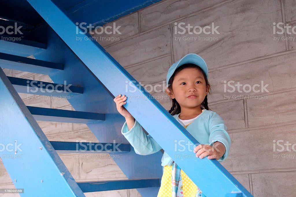 Little girl standing on the staircase royalty-free stock photo