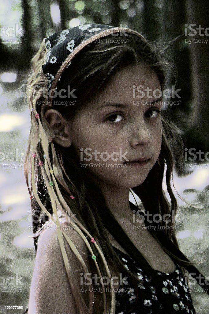 Little Girl Standing Outside and Looking at Camera stock photo