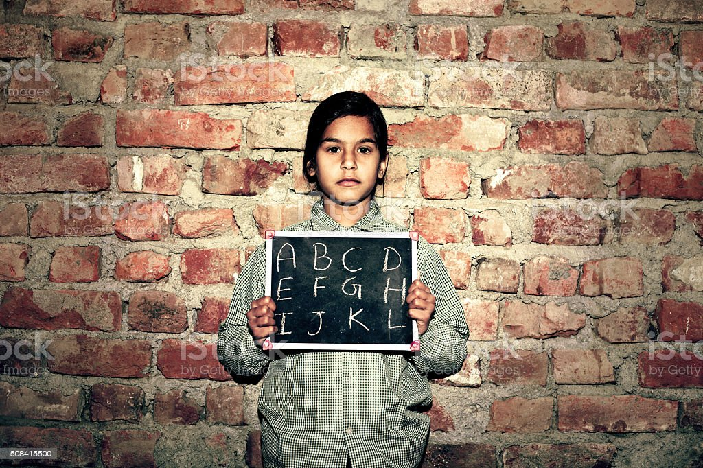 Little Girl Standing Portrait with Chalkboard stock photo