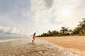 Little Girl Standing Running at Idyllic Deserted Beach