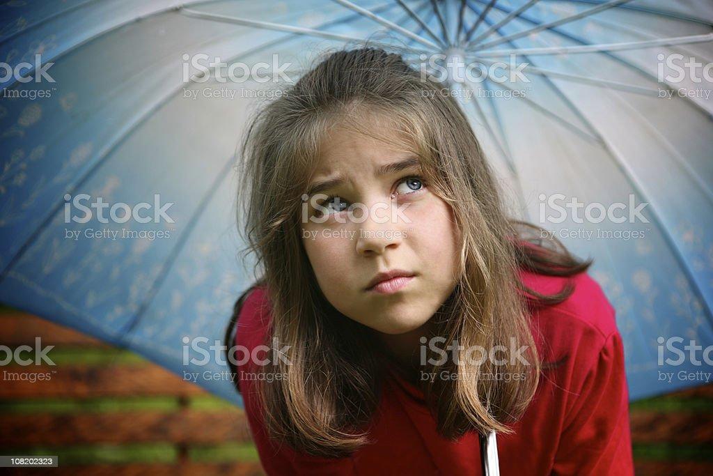 Little Girl Standing Under Blue Umbrella royalty-free stock photo