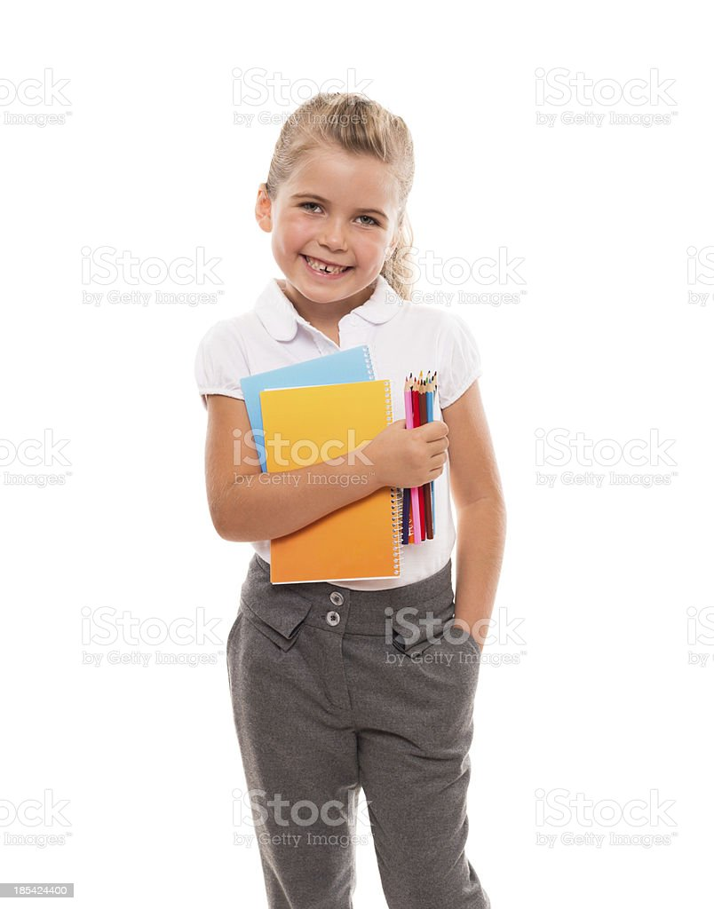 little girl standing with few colorful notebooks and pencils royalty-free stock photo