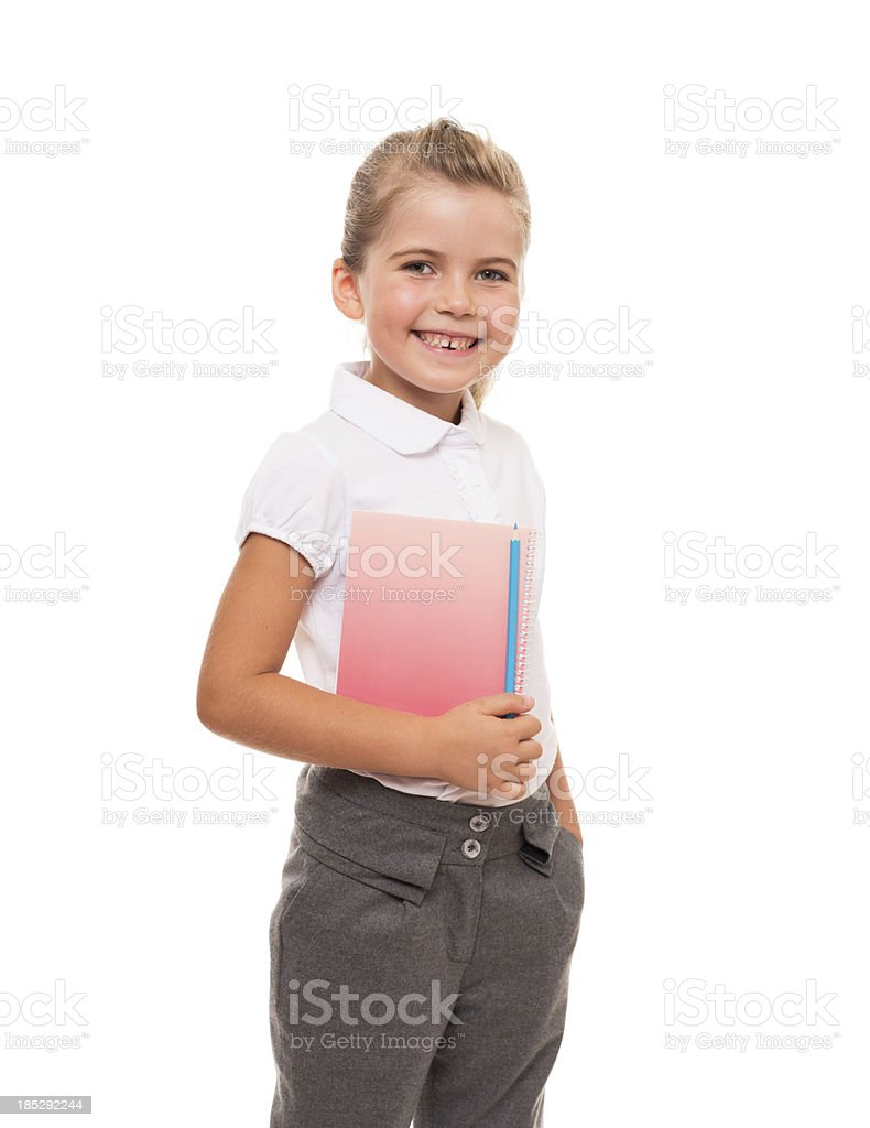 little girl standing with notebook and pencil royalty-free stock photo