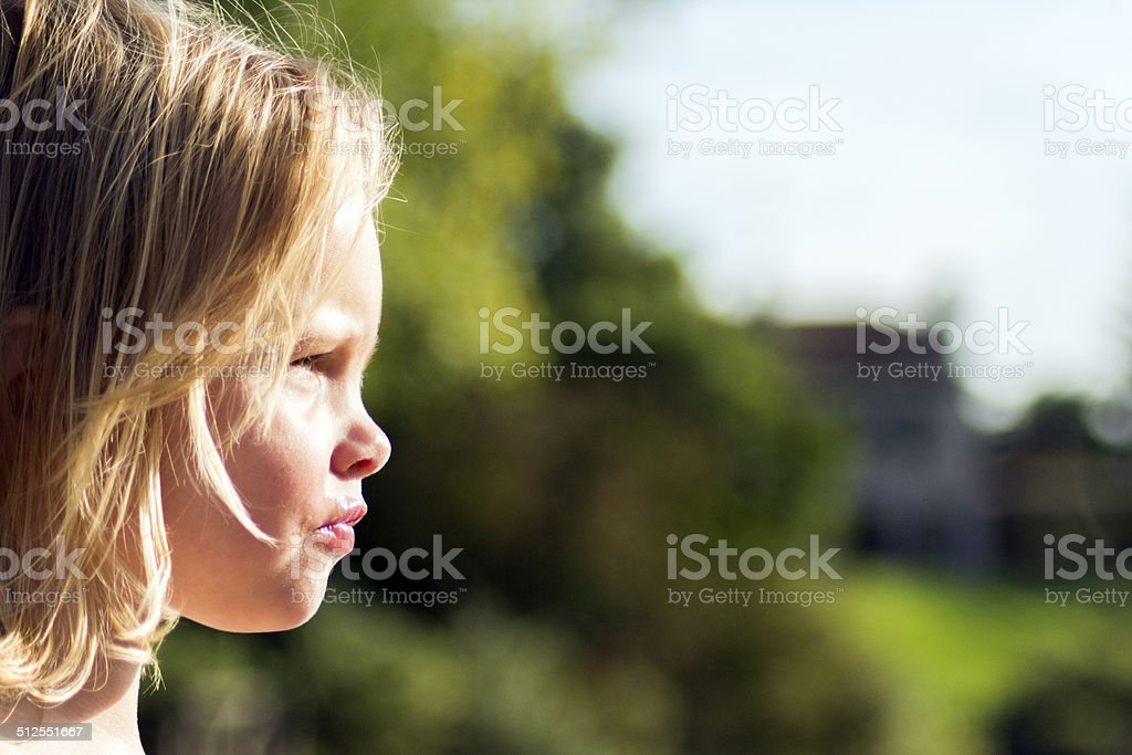 little girl stare and frown stock photo