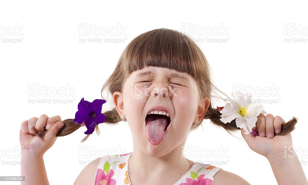Little girl  stick out tongues stock photo