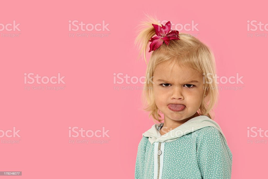 Little girl sticking her toung out. stock photo