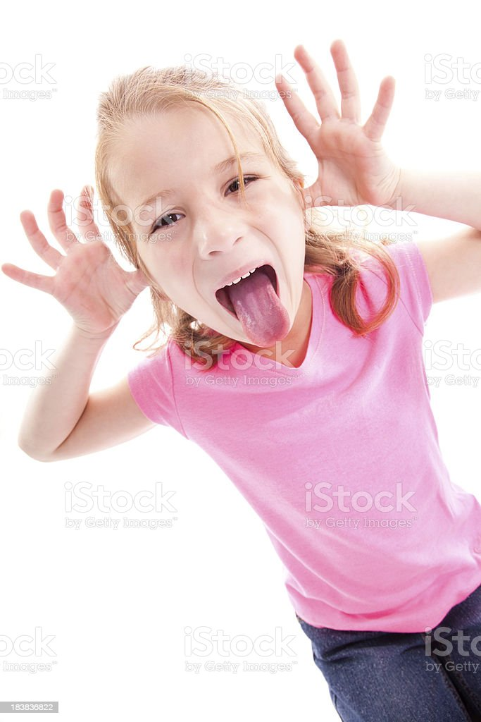 Little Girl Sticking Tongue Out, Isolated on White royalty-free stock photo