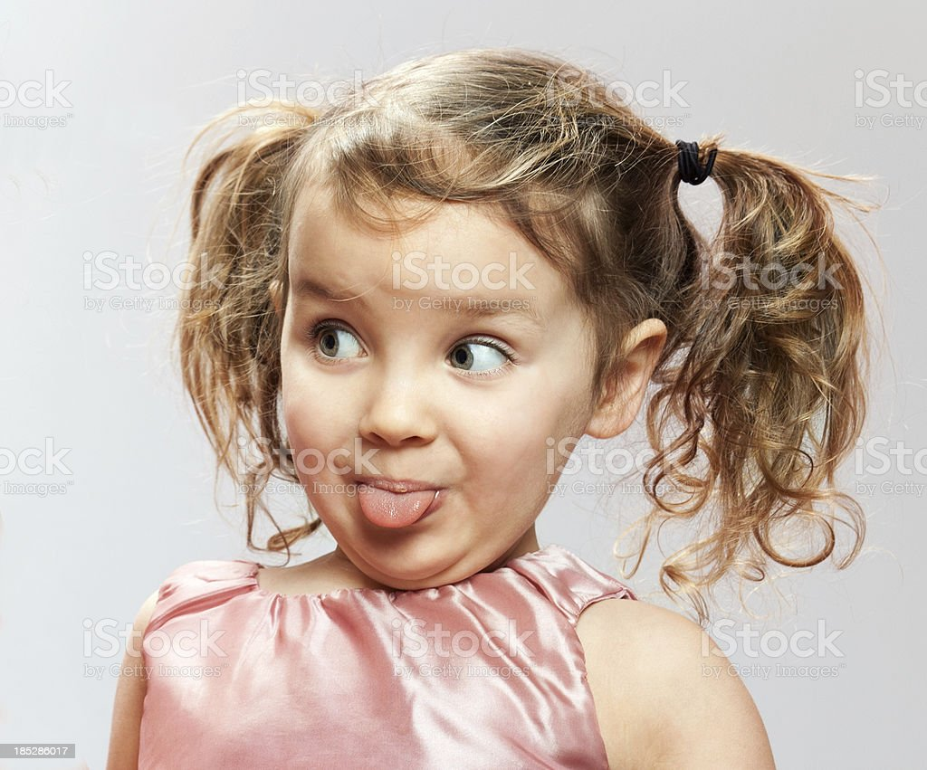 Little Girl Sticks Out Tongue stock photo