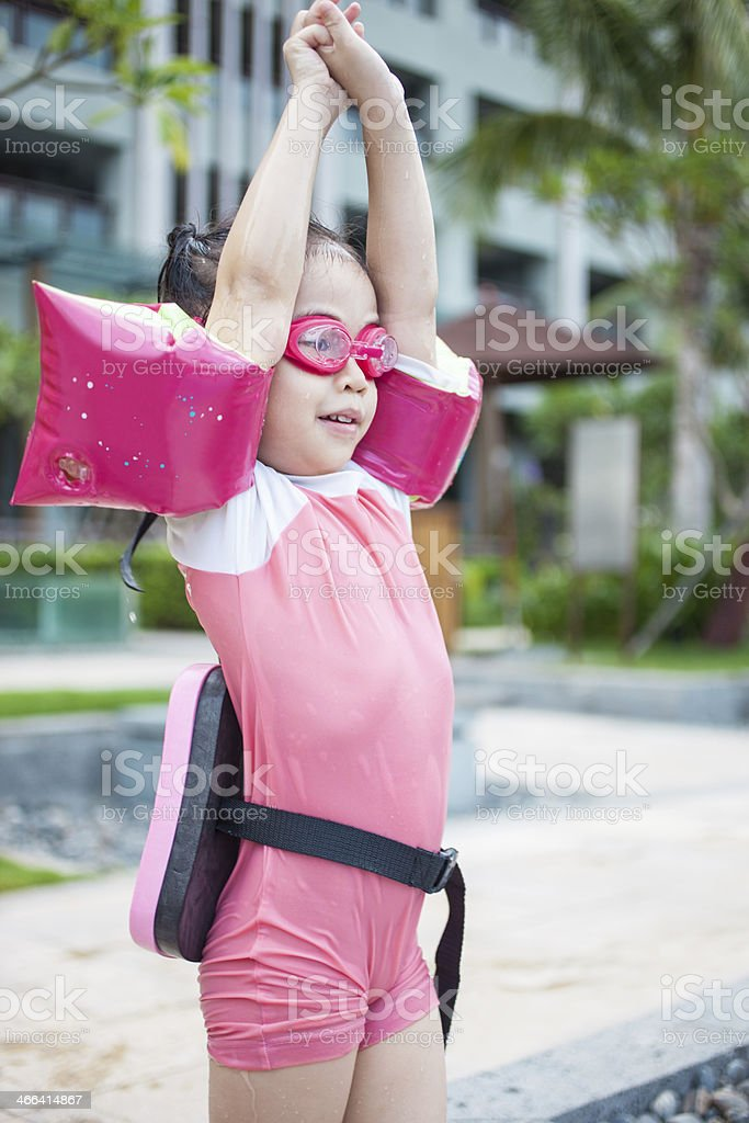 Little Girl Stretching Ready to Swim stock photo
