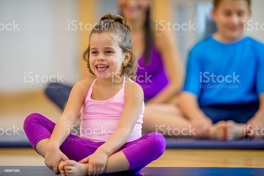 Little Girl Stretching with Her Family stock photo