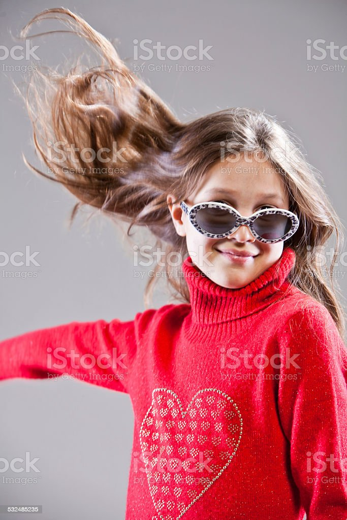little girl striking a pose stock photo