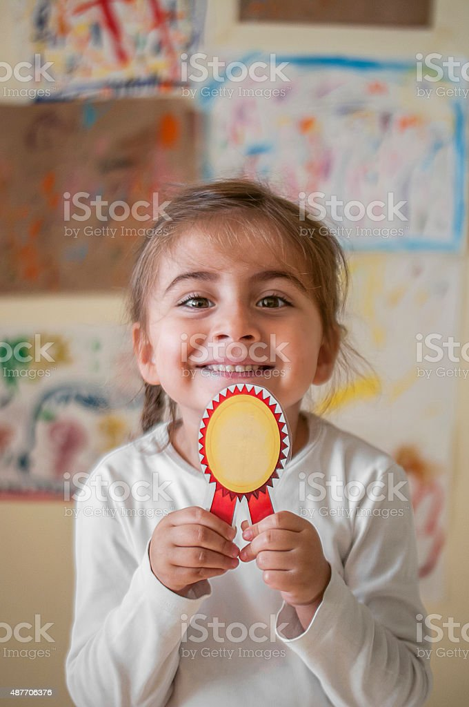 Little girl student with badge stock photo