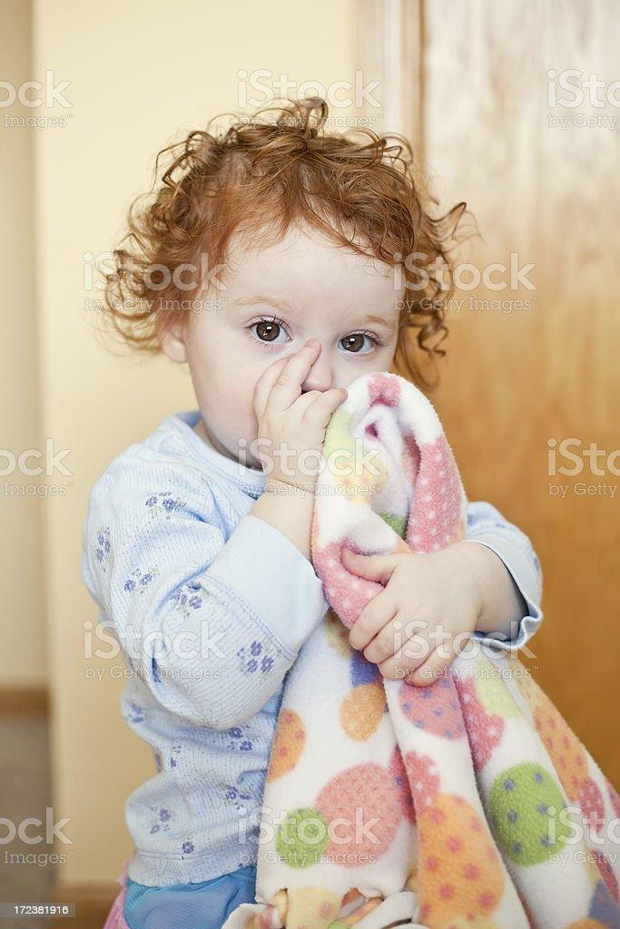 Little Girl Sucking Thumb With Blanket stock photo