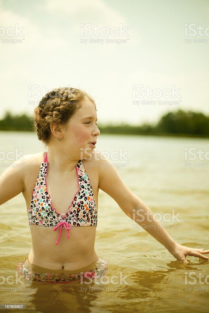 Little Girl swim in the lake royalty-free stock photo