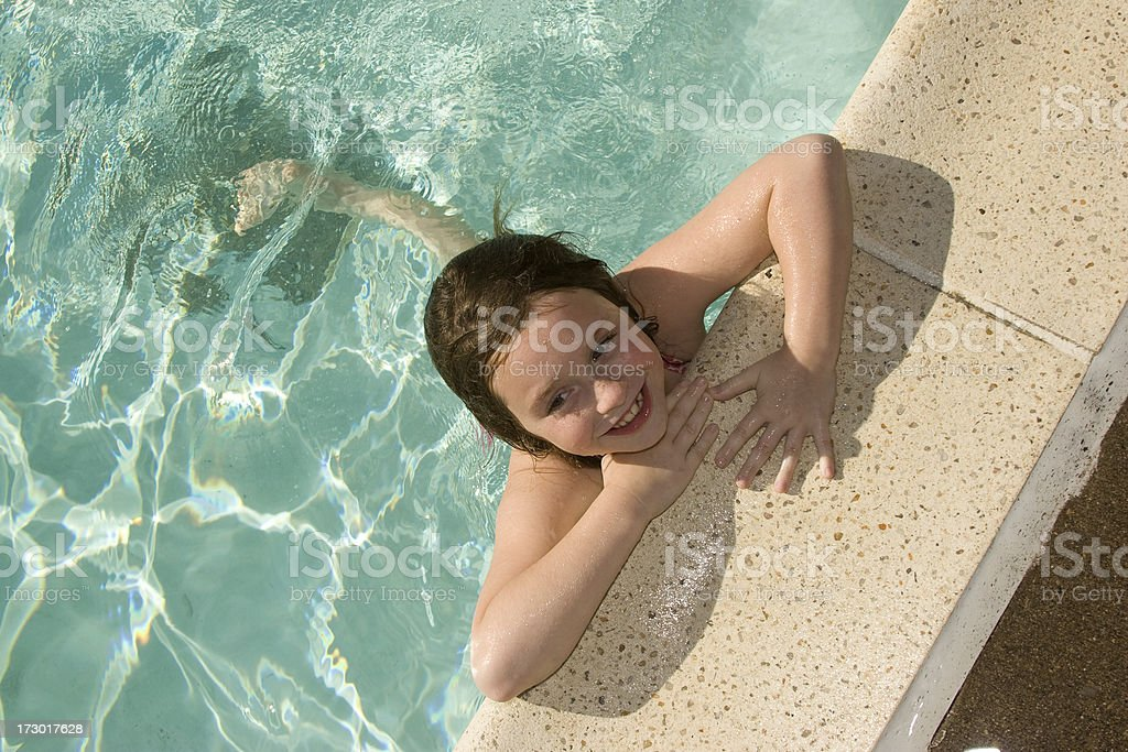 Little girl swim in the pool royalty-free stock photo