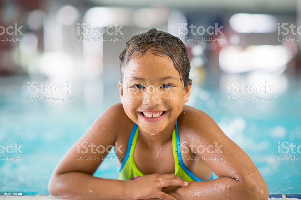 Little Girl Swimming at the Public Pool stock photo