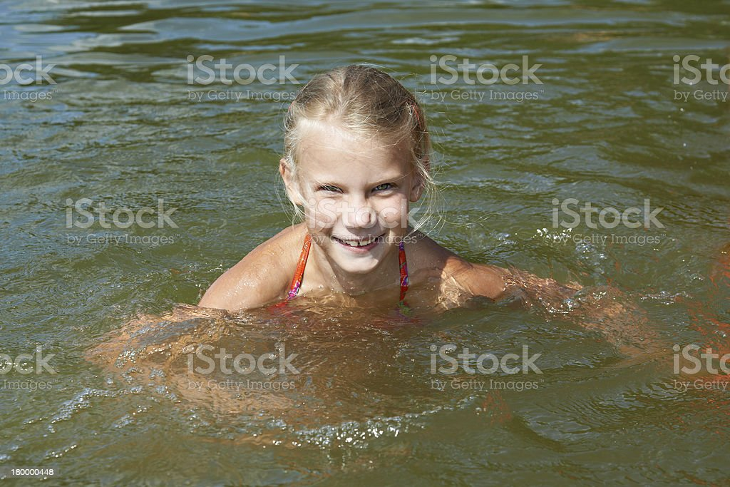 Little girl swimming in lake royalty-free stock photo
