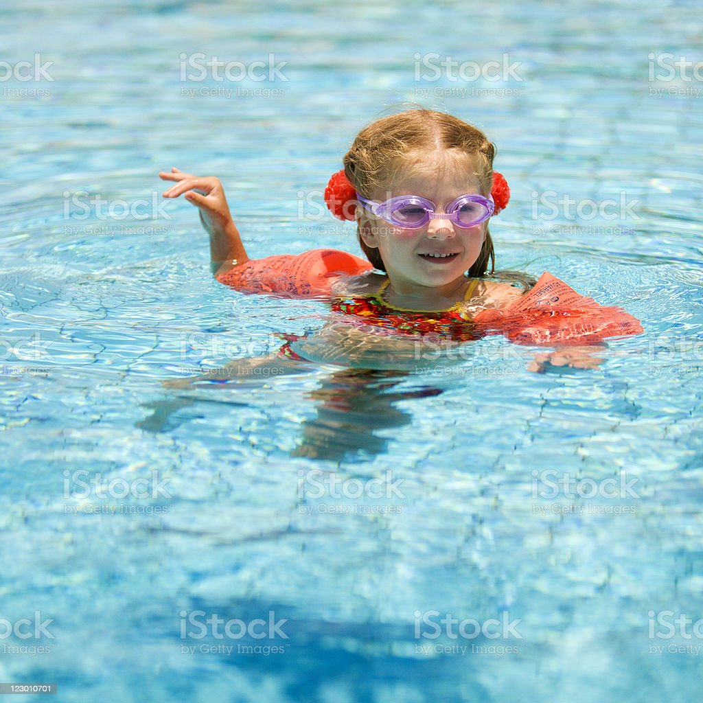 Little girl swimming in pool royalty-free stock photo
