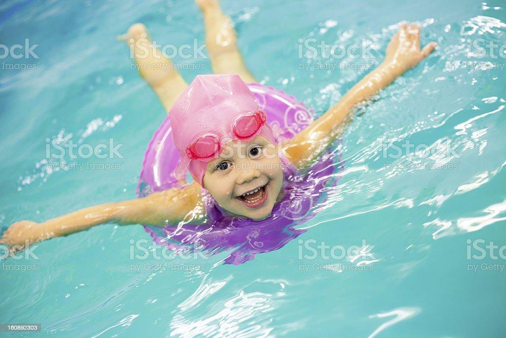 little girl swimming stock photo