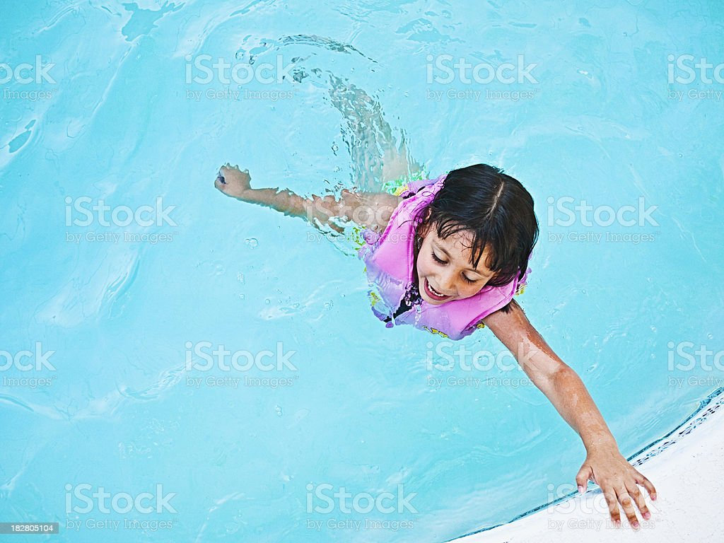 little girl swimming royalty-free stock photo