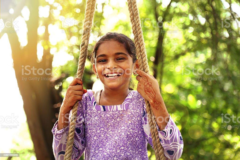 Little girl swinging stock photo