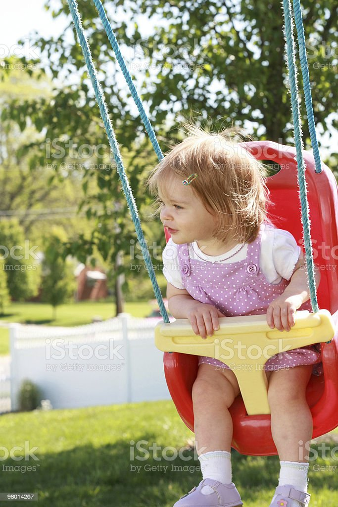 Little Girl Swinging royalty-free stock photo