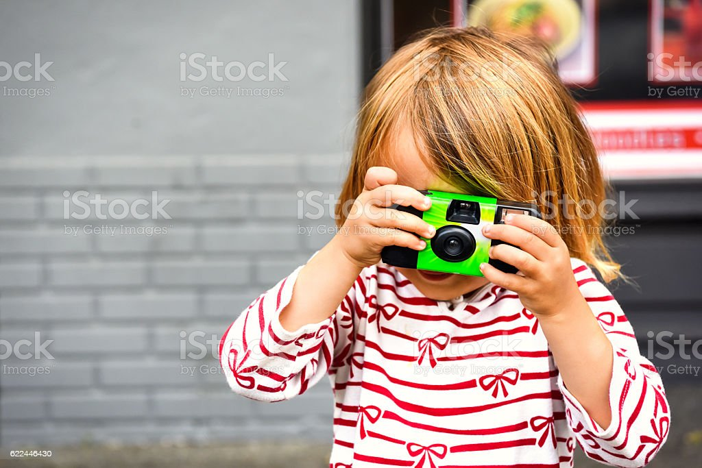 Little girl taking a picture stock photo