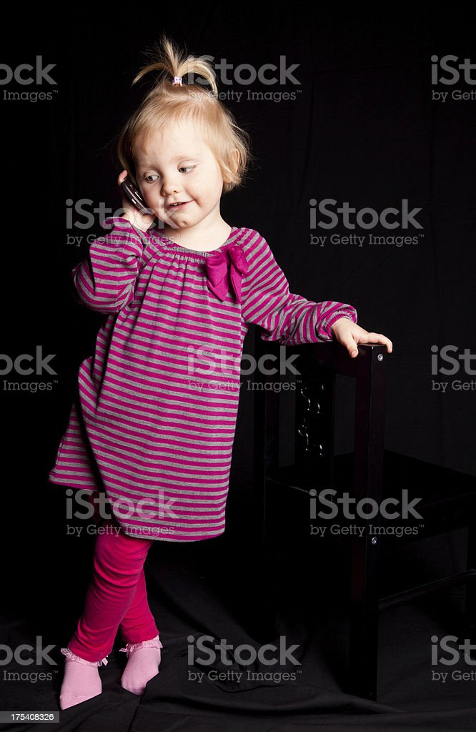 Little girl talking on the phone royalty-free stock photo